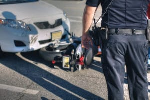 Police officer standing in front of motorcycle accident
